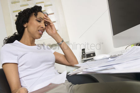 Lady : Worried woman doing finances
