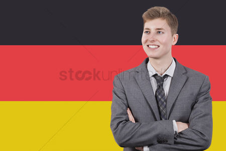 Respect : Young businessman with arms crossed over german flag