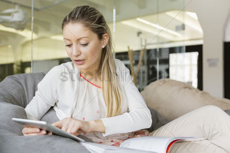 Czech republic : Young businesswoman using tablet pc in office