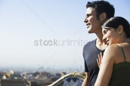 Smiling : Young couple enjoying view portrait