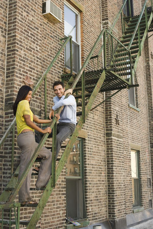 Staircase : Young couple on fire escape