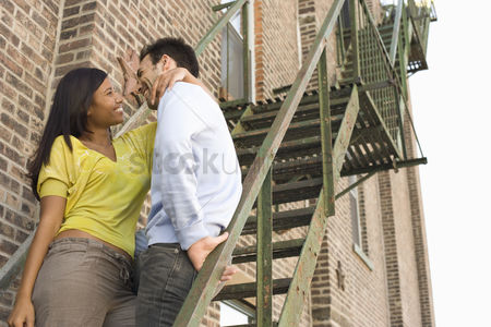 Attraction : Young couple on fire escape