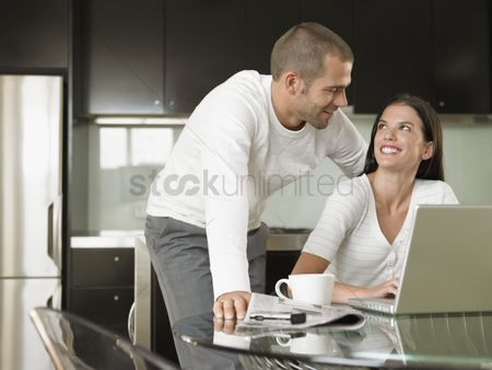 Modern lifestyle : Young couple using laptop