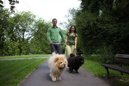 Girlfriend : Young couple walking with pet dogs