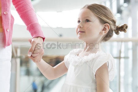 Czech republic : Young daughter holding mothers hand
