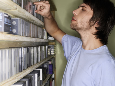 Collection : Young man browsing music collection side view
