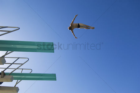 Diving : Young man diving from diving board