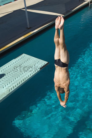 Diving : Young man diving into swimming pool