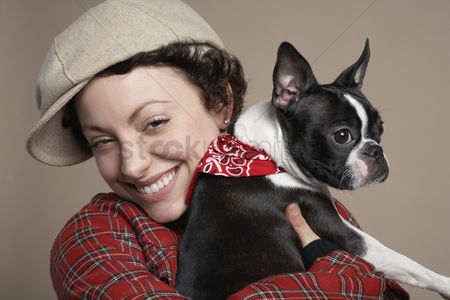 Fashion : Young woman holding french bulldog close-up
