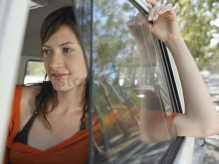 On the road : Young woman in camper van