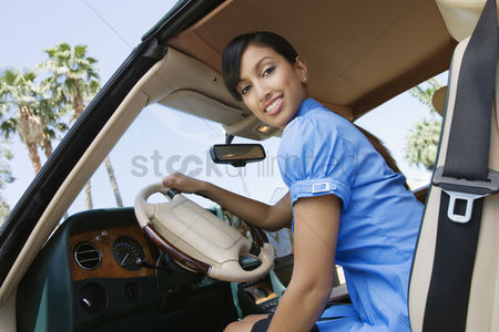 Posed : Young woman in car