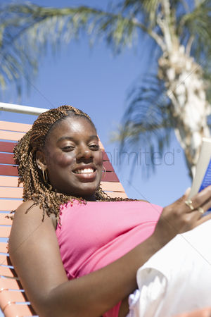 Satisfying : Young woman relaxing on vacation