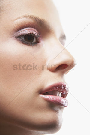 Glossy : Young woman s face with make-up