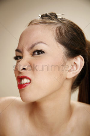 Frowning : Young woman showing her angry face