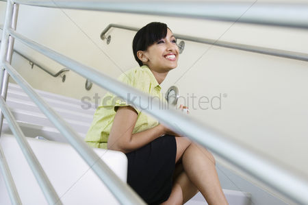 Steps : Young woman sitting on a stairway