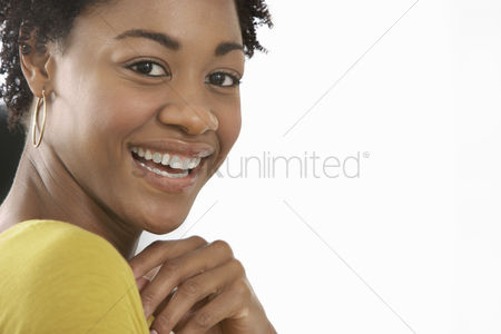 Black background : Young woman smiling close-up portrait