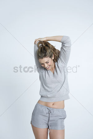 Ponytail : Young woman stretching