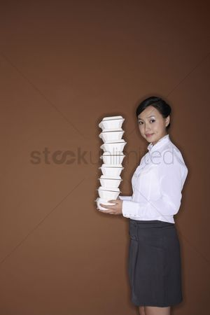 Careful : Young woman with a stack of take out food