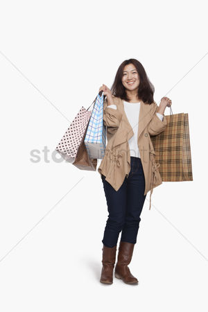 Spending money : Young woman with shopping bags