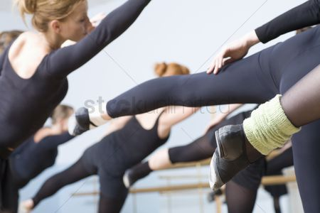 Dance : Young women stretch into ballet positions
