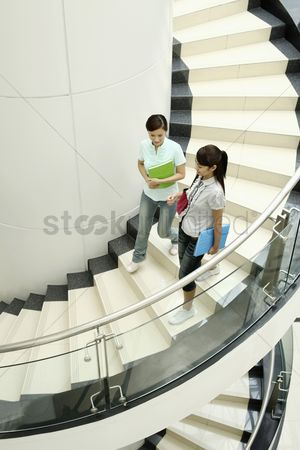 Staircase : Young women walking down the stairs together